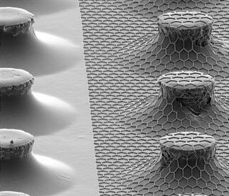 Tilted SEM images showing a hexagonal pattern array conformally imprinted on pre-patterend micro pillars structures using reverse NIL in a CNI tool.